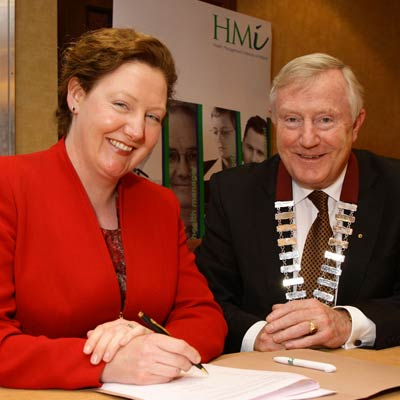 Cora Mc Caughan and Denis Doherty signing the Memo of Understanding