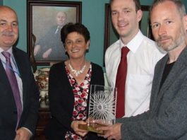 Will Andrews, chair of Dublin Cycling Campaign presents a Golden Pedal Award to Fergus Ashe, Allied Services Manager, Mona Baker, CEO and Padraig Ryan Padraig Ryan, Energy Coordinator of the Children's University Hospital, Temple Street