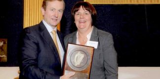 An Taoiseach , Enda Kenny, T.D. presenting the award to Julie Silke Daly