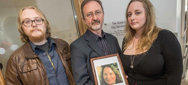 Mr. Fergus MacLiam, Mr. Conor MacLiam and Ms. Áine NicLiam with a photo of the late Susie Long at the opening of the Susie Long Day Services Unit at St Luke's General Hospital, Carlow-Kilkenny