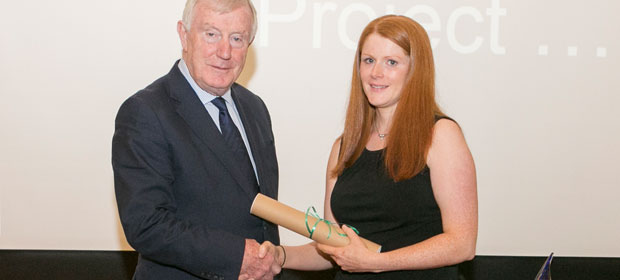 Margaret McGrath receiving a commendation from HMI Awards Judge, Denis Doherty