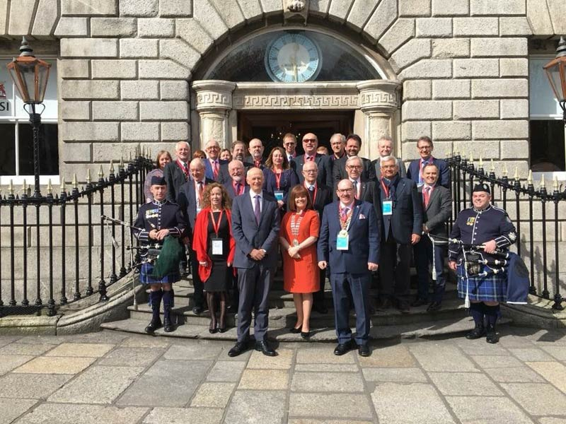 Some of the those who attended the EAHM Conference, pictured with, EAHM Council members  and members of the National Ambulance Service Pipe Band.